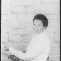 [Portrait of Althea Gibson, holding tennis ball and racket]