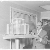 Mr. Raymond Loewy. With model, Imperial House II