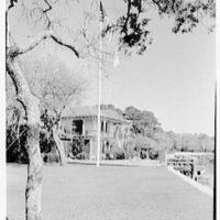 Mrs. Reynolds Bagley, Musgrove Plantation, residence on St. Simons Island, Georgia. Main house with flag, from east