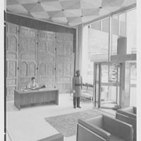 First National City Bank, International Division, Park Ave. and 53rd St., New York. Entrance section, with Japanese receptionist and Indian doorman